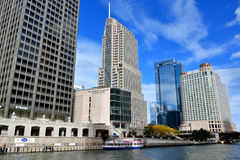 Skyscrapers beside Chicago river. City skyscrapers around Chicago river at North Michigan Avenue and the Michigan Avenue. Chicago, Illinois, United States Royalty Free Stock Images