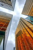 Skyscrapers with clouds reflection Stock Images
