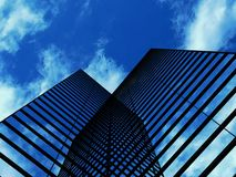 Skyscrapers with clouds reflection Royalty Free Stock Photos