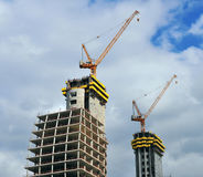 Skyscrapers construction scene. View of skyscrapers construction with the blue sky on background Stock Image