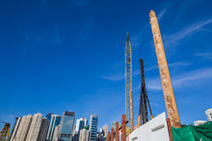 Skyscrapers and construction site. With blue sky Royalty Free Stock Photography