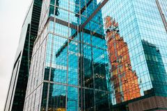 Skyscrapers in downtown. Modern buildings exterior design and reflection in glass. Detail close-up stock images
