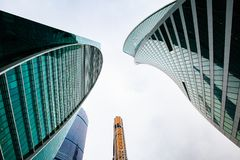Skyscrapers in downtown. Modern buildings with glass facades. Looking up city. Urdan landscape royalty free stock images