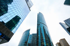 Skyscrapers in downtown. Modern city buildings exterior design, glass facades. royalty free stock photos