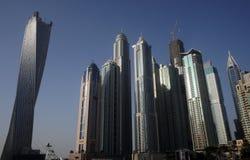 Skyscrapers in Dubai against the blue sky. Stock Photos