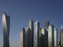 Skyscrapers in Dubai against the blue sky. Royalty Free Stock Photos