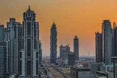 Skyscrapers in Dubai. Dubai skyscrapers cityscape at sunset on December 31, 2014 in Dubai, United Arab Emirates Royalty Free Stock Photos