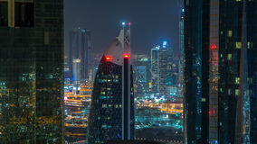 Skyscrapers of dubai during night hours timelapse. Close up view between two illuminated towers to Dubai downtown from Sheikh zayed road. Aerial top view stock video footage