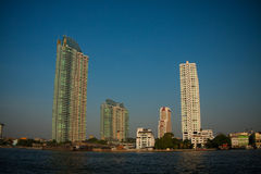 Skyscrapers at evening near water, The Building near the river. Stock Images