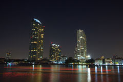 Skyscrapers at evening near water, The Building near the river. Royalty Free Stock Photo