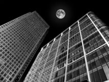 Skyscrapers with a full moon stock image