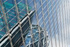 Skyscrapers glass facades in Paris business center La Defense. Urban architecture, modern office buildings. Abstract. Background with sky reflection. City life Royalty Free Stock Photography