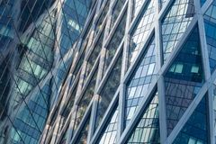 Skyscrapers glass facades in Paris business center La Defense. Urban architecture, modern office buildings. Abstract. Background with sky reflection. City life Royalty Free Stock Images