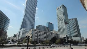 Skyscrapers and glass office buildings in Warsaw city center. Tracking shot between skyscrapers and glass office buildings in Warsaw city center stock footage