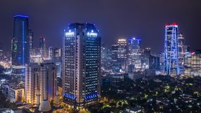 Skyscrapers with glowing light in Jakarta downtown stock photography