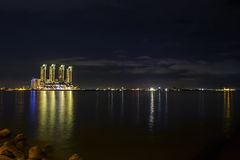 Skyscrapers Green Bay Pluit in modern Jakarta after sunset reflecting golden colors, view fro Stock Photo