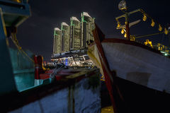 Skyscrapers Green Bay Pluit in modern Jakarta after sunset reflecting, view from harbor Royalty Free Stock Photography