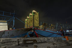 Skyscrapers Green Bay Pluit in modern Jakarta after sunset reflecting, view from harbor Royalty Free Stock Image