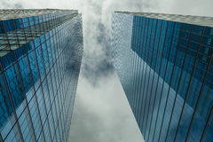 Skyscrapers hacks clouds in the blue sky Stock Image