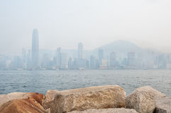 The skyscrapers of Hong Kong's financial district and Victoria Peak obscured by air pollution Stock Images