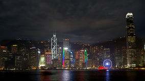 Skyscrapers of Hong Kong. World famous skyline at night with red Stock Photo