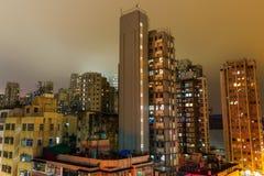 Skyscrapers in Kowloon, Hong Kong, at night Stock Photos