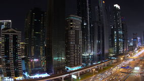 Skyscrapers lining Sheikh Zayed Road at dusk Dubai. View down skyscrapers lining Sheikh Zayed Road at dusk, Dubai, United Arab Emirates stock video
