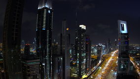 Skyscrapers lining Sheikh Zayed Road at dusk, Dubai stock video