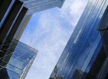 Skyscrapers. Looking up to the sky between two modern buildings Royalty Free Stock Photography