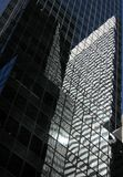 Skyscrapers with lots of glass. With reflestion of another building (Manhattan Royalty Free Stock Images