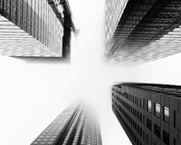 Skyscrapers during low-lying clouds and fog in Toronto Royalty Free Stock Photo