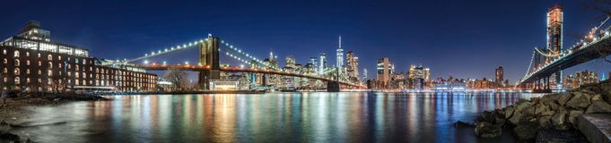 The skyscrapers of Lower Manhattan, the Brooklyn Bridge and the Manhattan Bridge in evening royalty free stock photos