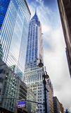Skyscrapers_01. The skyscrapers of Manhattan against the blue sky and clouds Royalty Free Stock Images