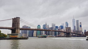 Skyscrapers of Manhattan and Brooklyn Bridge, New York City. Fast clouds float over the skyscrapers, cloudy weather stock video footage