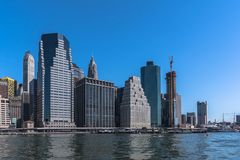 Skyscrapers along the East River, Manhattan, NYC. Skyscrapers of Manhattan view from the East River, New York City stock image
