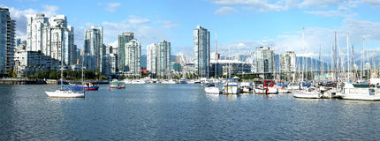 Skyscrapers & marina in False Creek Vancouver BC. Stock Image