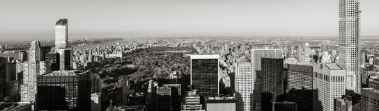 Skyscrapers of Midtown Manhattan and Central Park Reservoir in Black & White. New York City Royalty Free Stock Photos