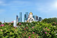 Skyscrapers of Moscow and the Church of St. George the Victorio stock photo