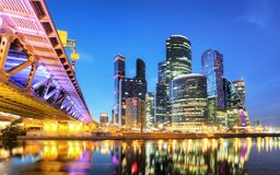 Skyscrapers of Moscow City business center and Moscow river in Moscow at night, Russia. Architecture and landmark of Moscow stock images