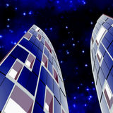 Skyscrapers At Night. Illustration of two tall towers or high rise buildings and at night under a blue starry sky Stock Photo
