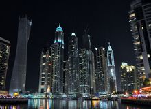Skyscrapers at night in Marina Dubai. Light reflections in Marina walk at Dubai, skyscrapers Twist tower, Princess tower, Hotel Marriott, Pinnacle, the Waves Stock Photography