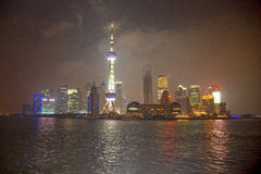 Skyscrapers by night, Shanghai, China. View of the Oriental Pearl tower across the Huangpu river, Shanghai, China stock image
