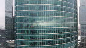 Skyscrapers. Office windows with city reflected in it. Nobody. Close up aerial shot. stock footage