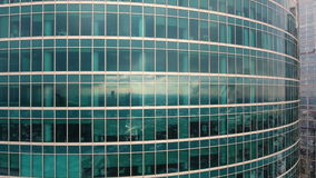 Skyscrapers. Office windows with city reflected in it. Nobody. Close up aerial shot. stock video footage
