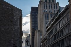 Skyscrapers and older buildings in Old Montreal Vieux Montreal, Quebec, Canada. Old Montreal is one of oldest parts of America royalty free stock photos