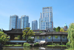 Skyscrapers over look Chinese garden, Stock Images