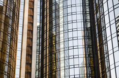 Skyscrapers reflected. On mirrored glass windows in urban environment Royalty Free Stock Image