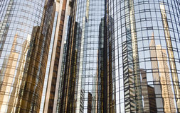 Skyscrapers reflected. On mirrored glass windows in urban environment Royalty Free Stock Images