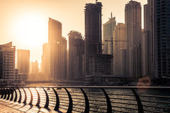 Skyscrapers silhuette at sunset in Dubai marina Stock Photos