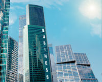 Skyscrapers with sun Stock Images